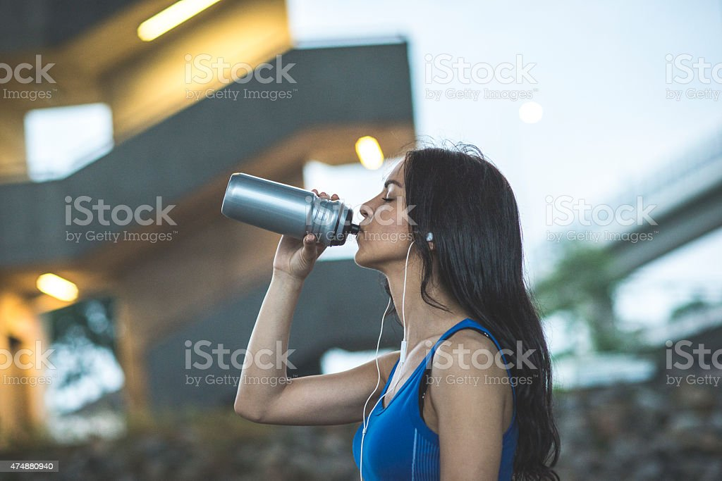 Girl drinking cold water stock photo