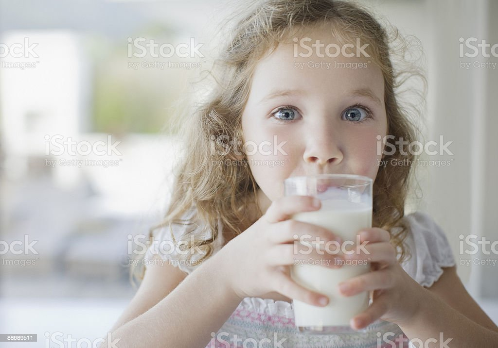 Girl drinking glass of milk royalty-free stock photo
