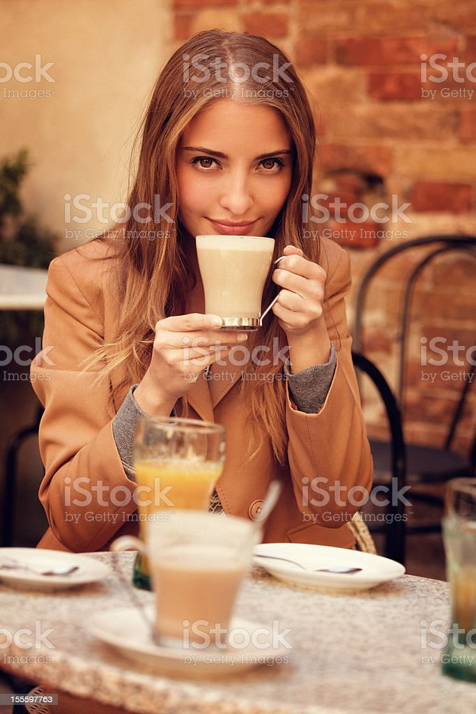 girl drinking latte machiato royalty-free stock photo