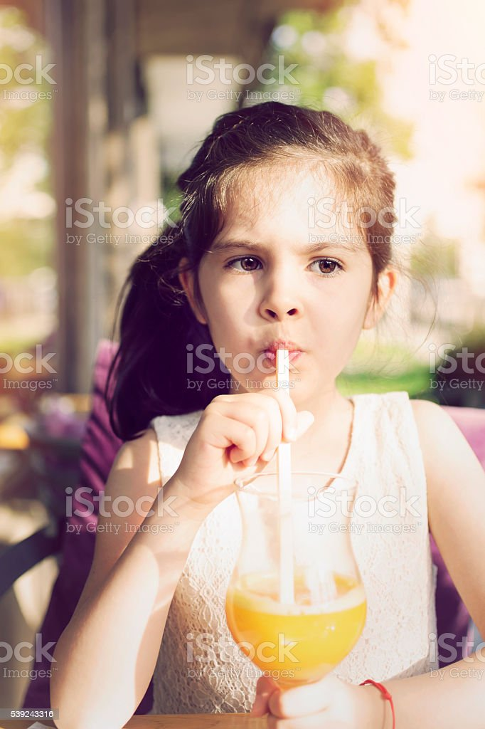 Girl Drinking Orange Juice stock photo