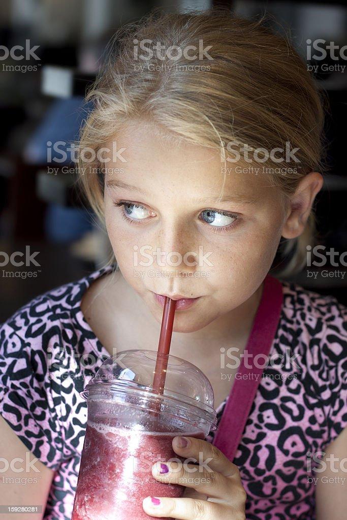 Girl drinking smoothie royalty-free stock photo