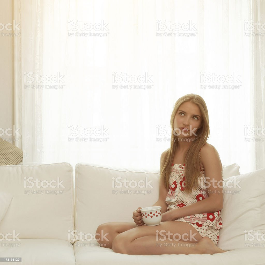 girl drinking tea or coffee in the morning stock photo