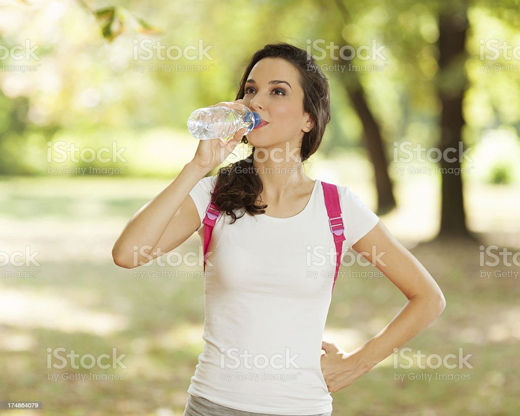 Girl drinking water after sport royalty-free stock photo