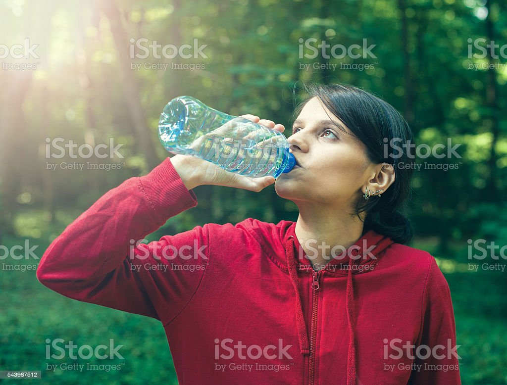 Girl drinking water from the bottle royalty-free stock photo