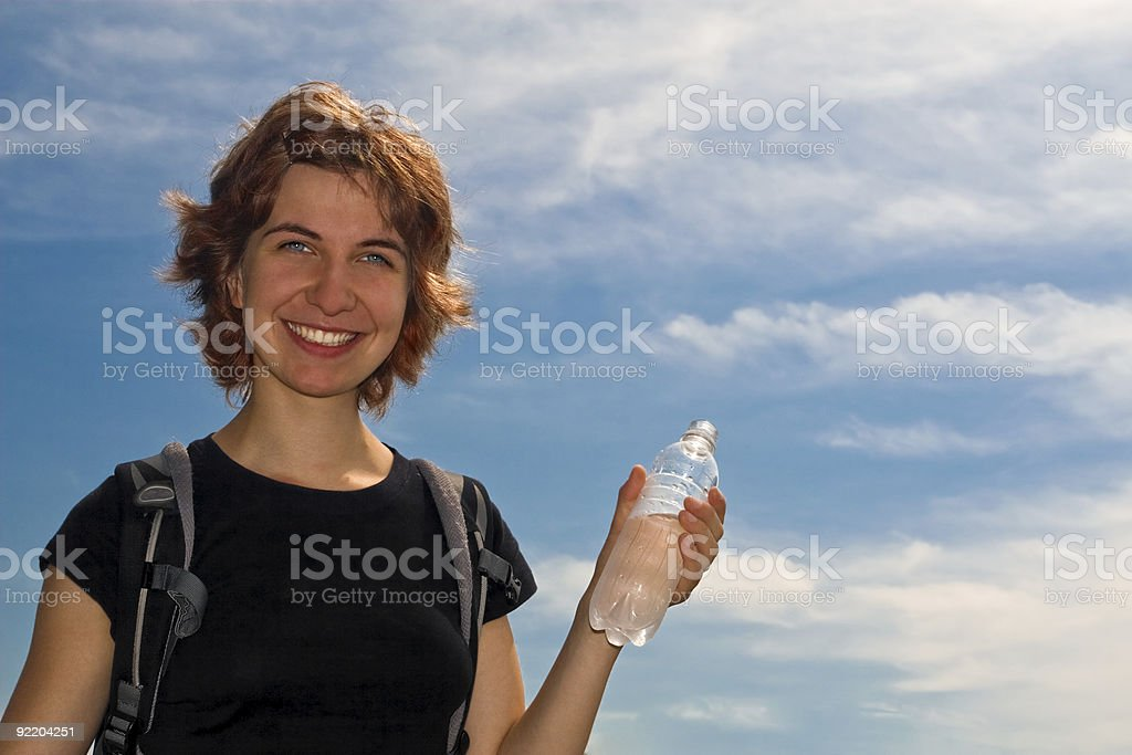 Girl drinking water outdoors royalty-free stock photo