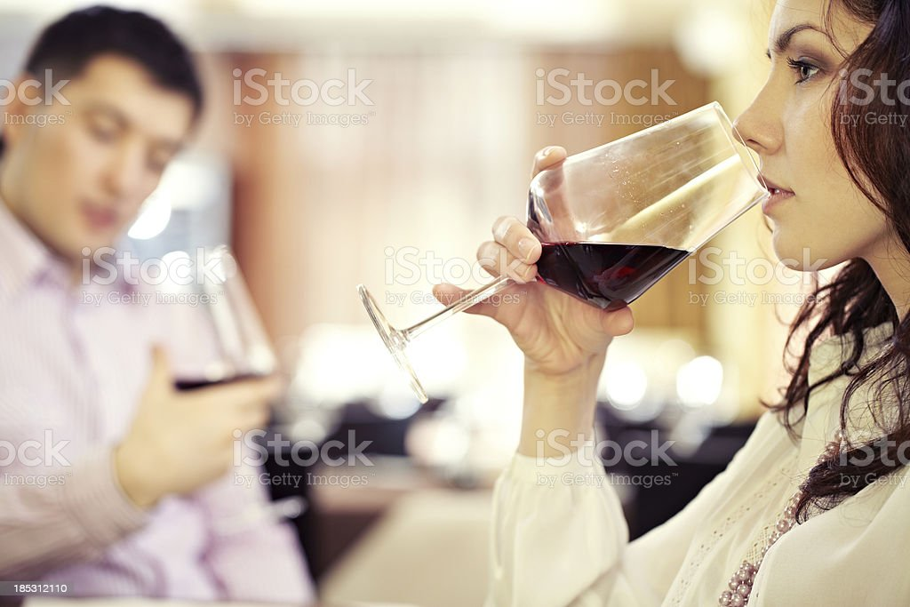 Girl drinking wine royalty-free stock photo