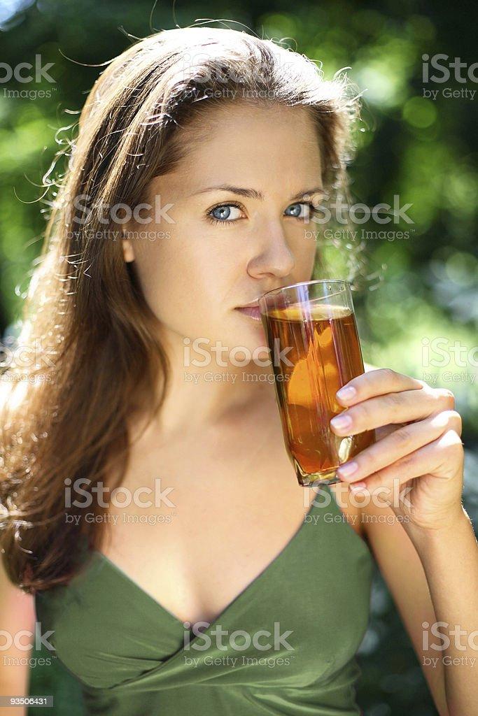 girl drinks apple juice royalty-free stock photo