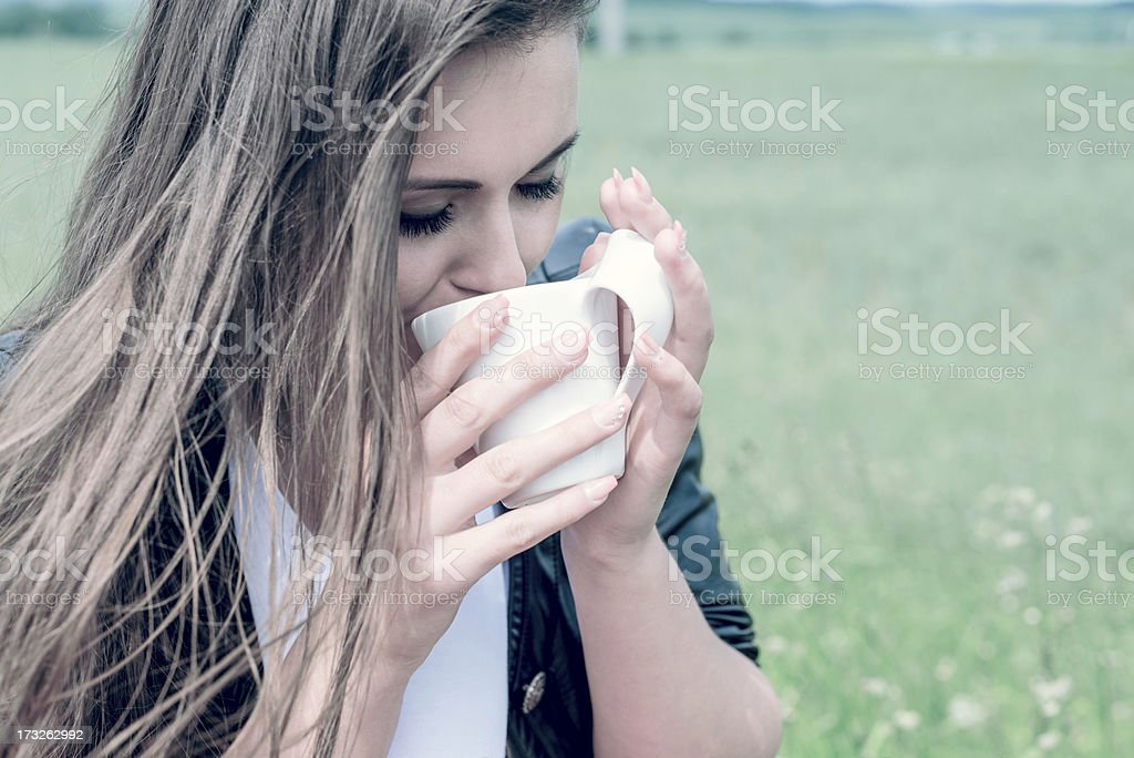 girl drinks coffee with pleasure outdoors royalty-free stock photo