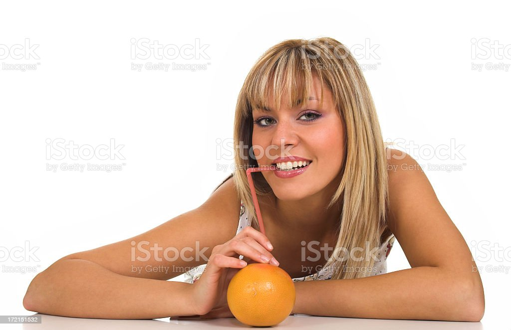 Girl drinks orange juice royalty-free stock photo