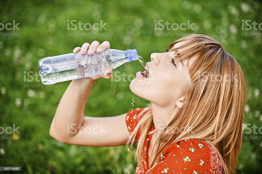 Girl drinks water royalty-free stock photo