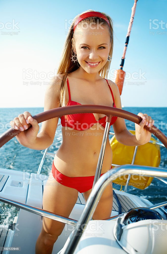 Girl driving a yacht royalty-free stock photo