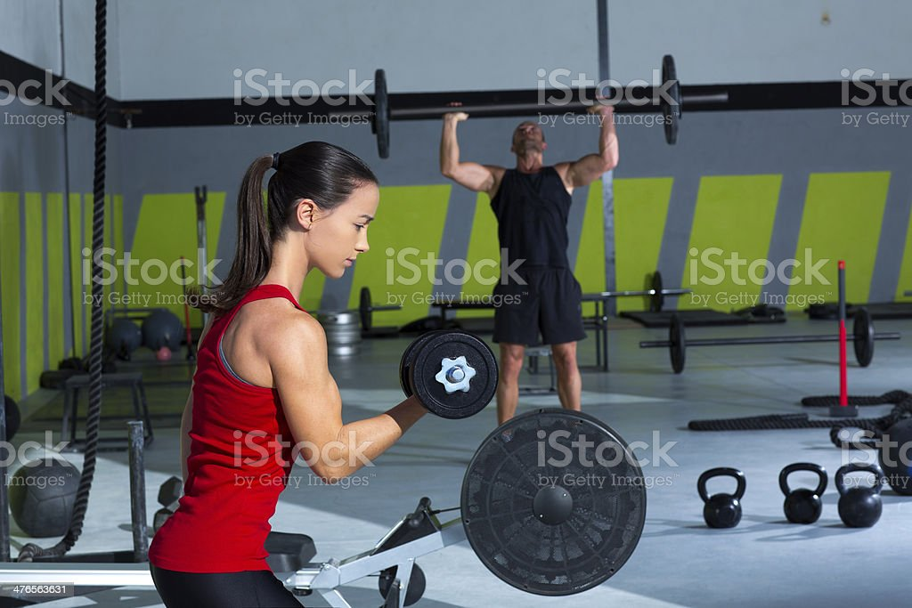 girl dumbbell and man weight lifting bar workout royalty-free stock photo