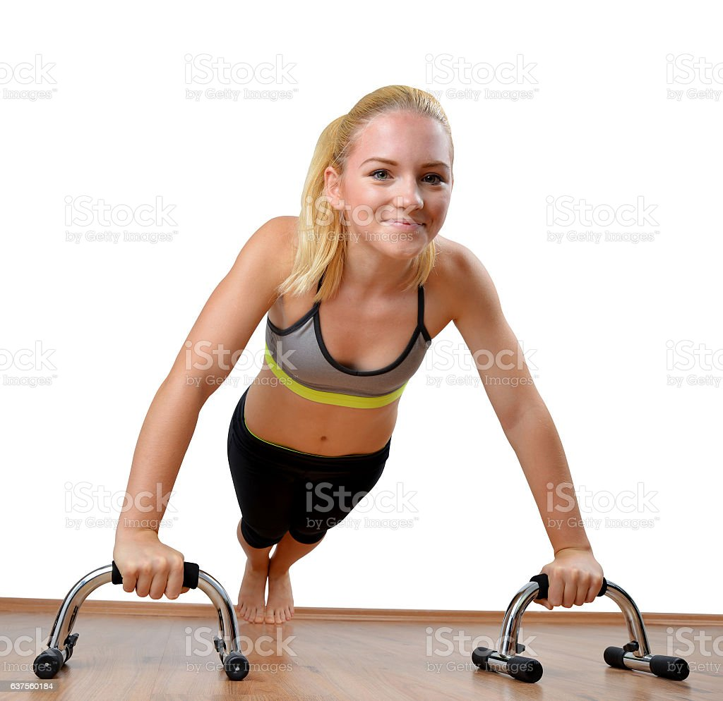 Girl during exercise pectoral muscles on white background. stock photo