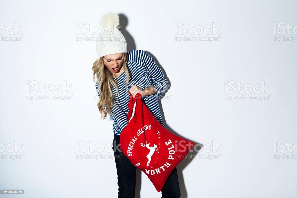 Girl eagerly unpacking Christmas presents stock photo