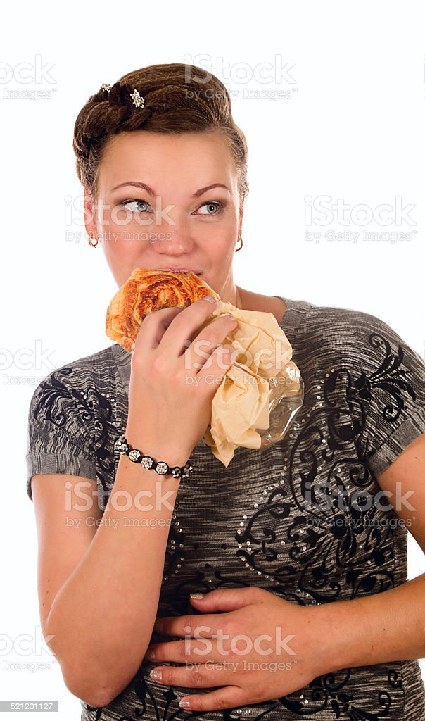 girl eating a bun stock photo