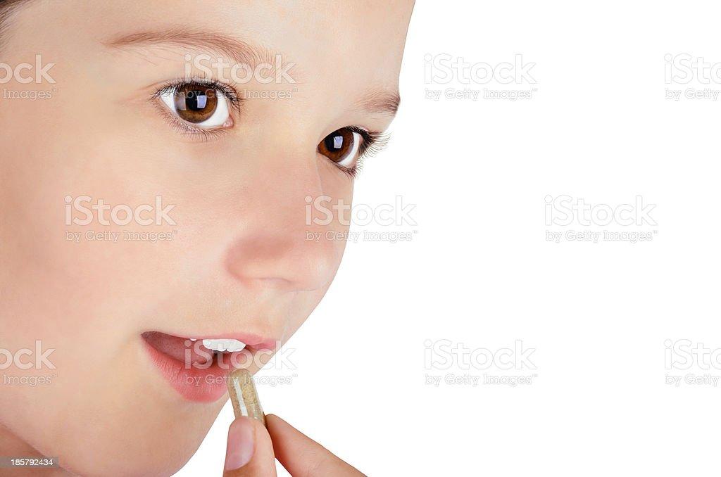 girl eating a pill closeup royalty-free stock photo