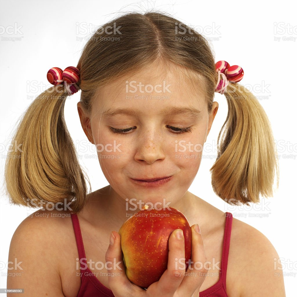 girl eating an apple royalty-free stock photo