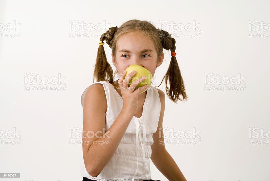 Girl eating apple I royalty-free stock photo