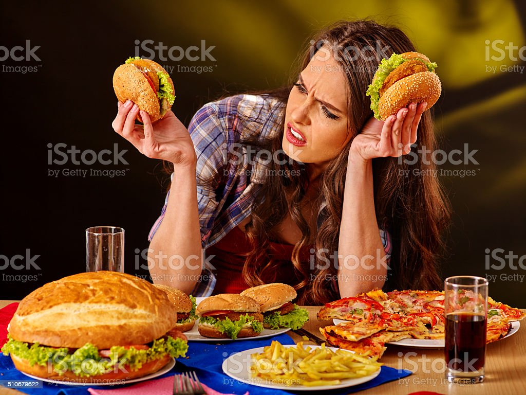 Girl eating big sandwich stock photo