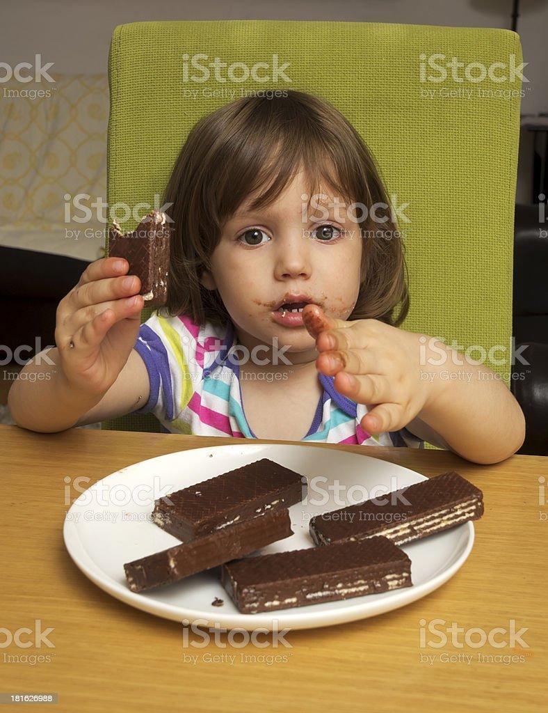 Girl eating cookies stock photo