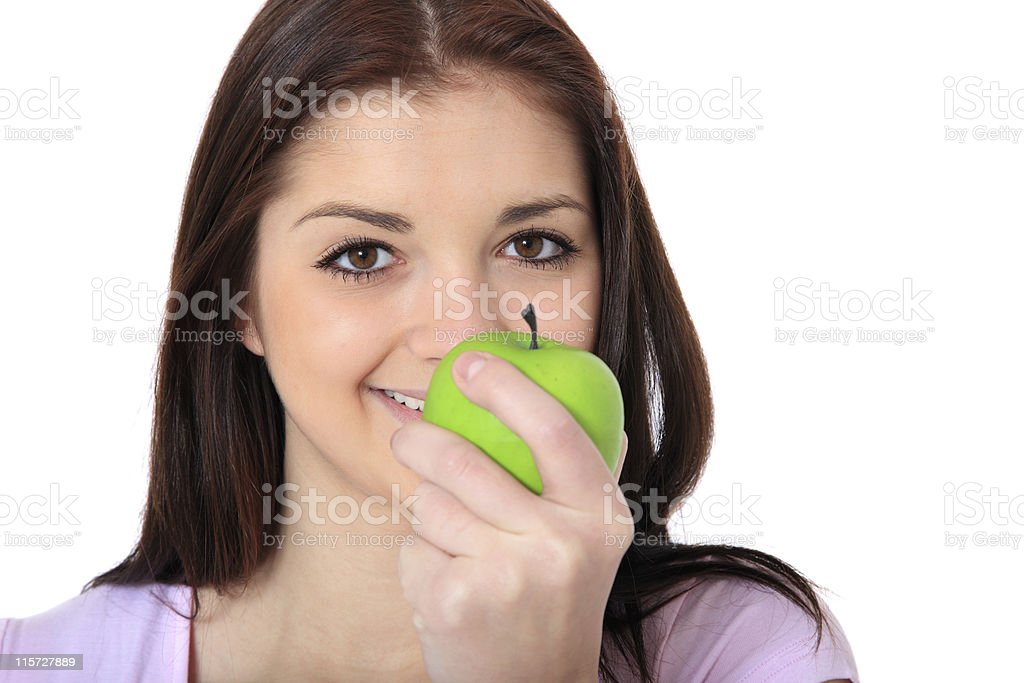 Girl eating green apple royalty-free stock photo