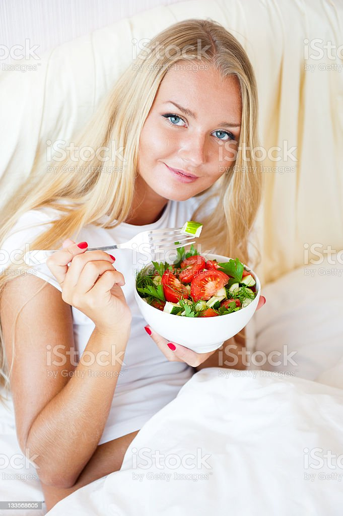 girl eating healthy food at bed royalty-free stock photo