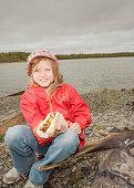 Girl eating hotdog