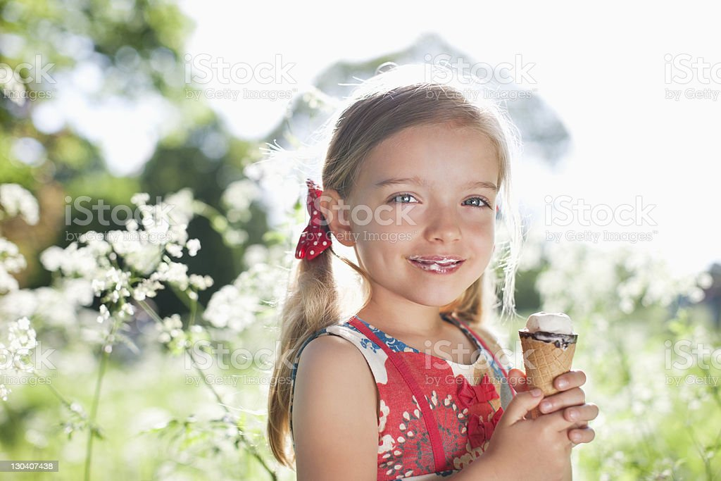 Girl eating ice cream outdoors royalty-free stock photo
