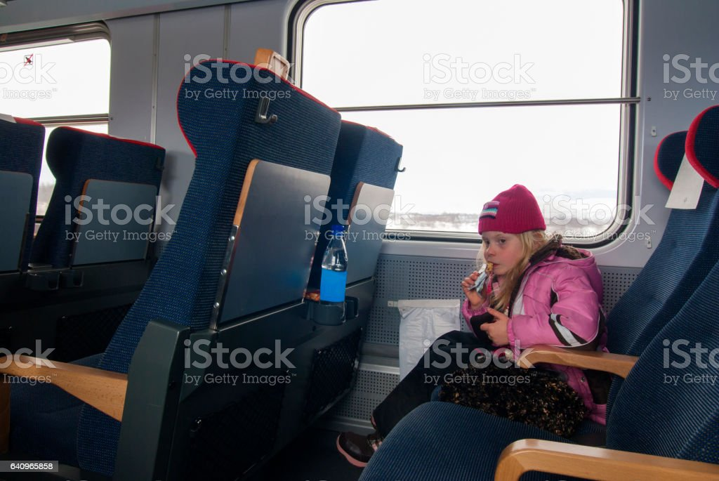 Girl eating on the train stock photo