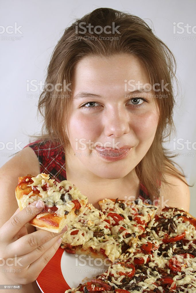 Girl eating Pizza royalty-free stock photo