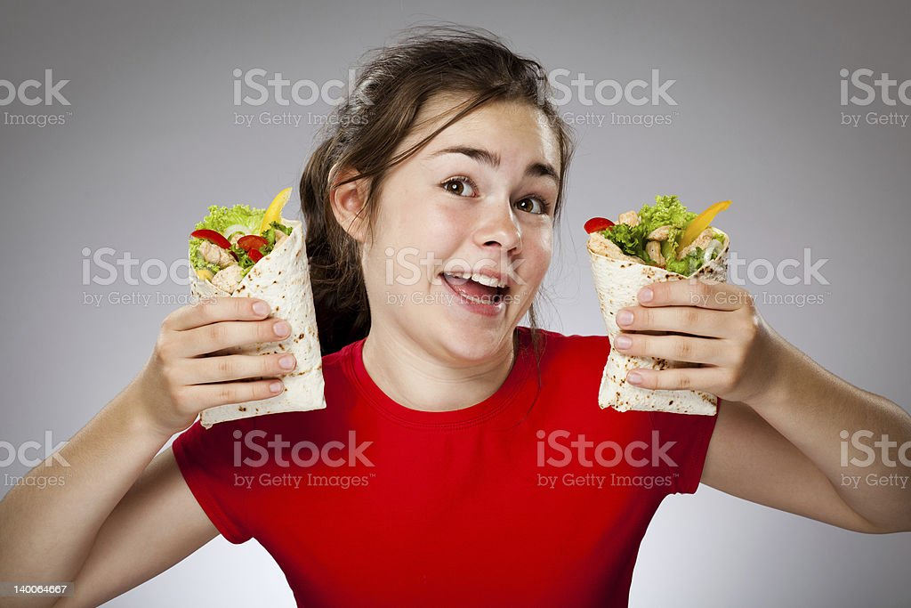 Girl eating sandwiches royalty-free stock photo