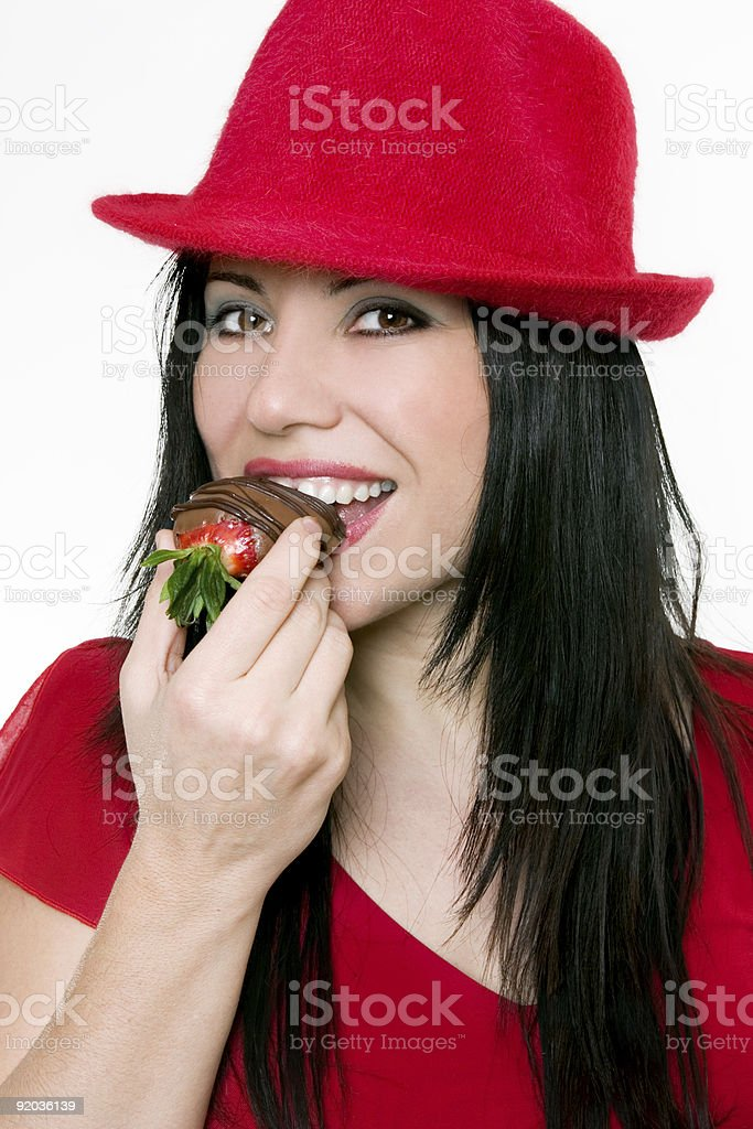 Girl eating strawberries royalty-free stock photo