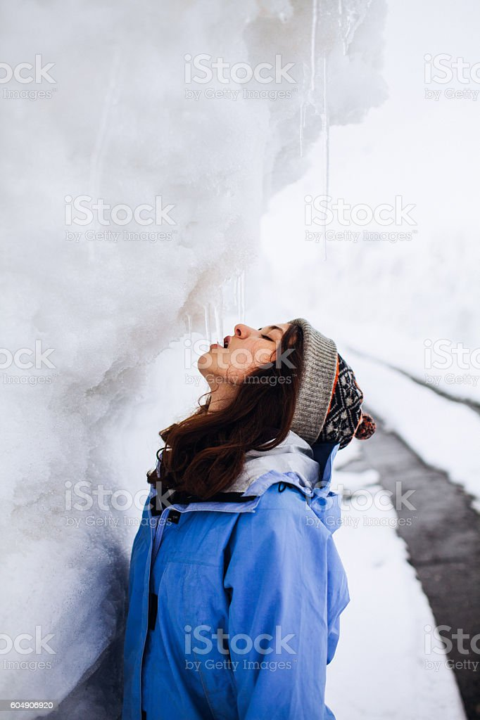 Girl eats icicle stock photo
