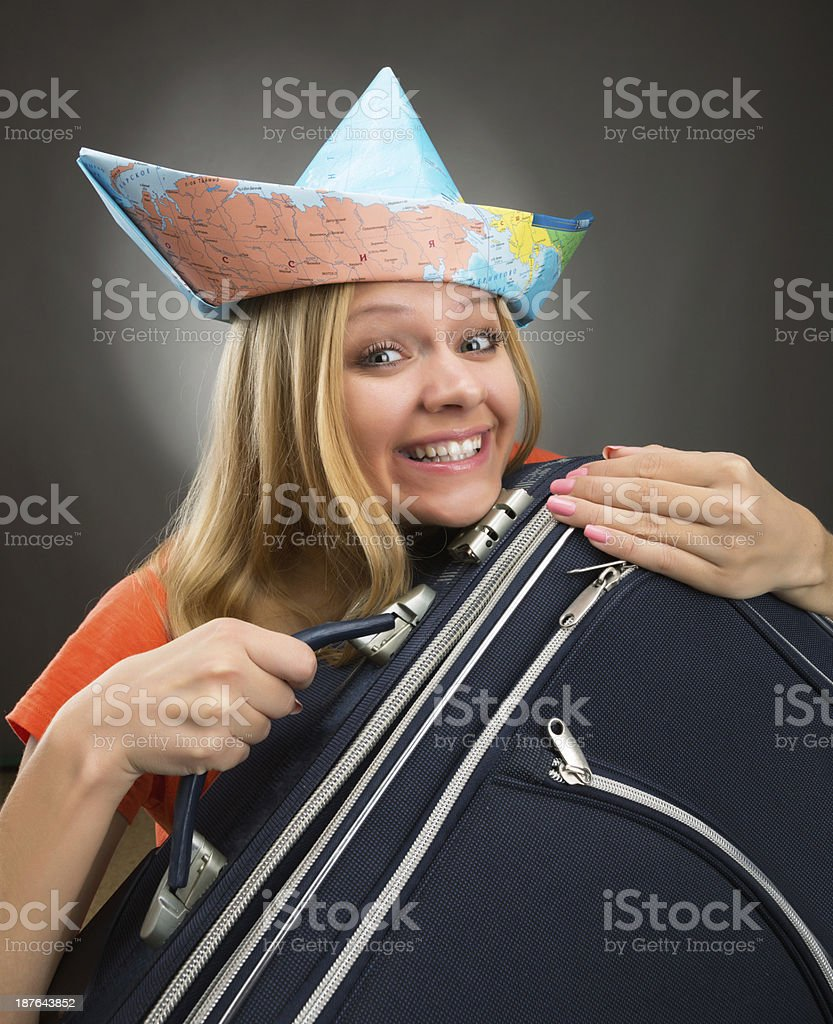 Girl embracing suitcase stock photo