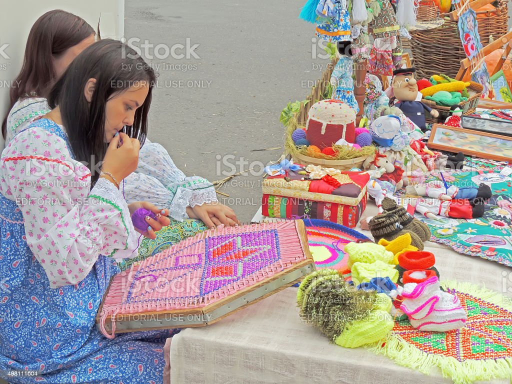 Girl embroiderer thread a needle stock photo