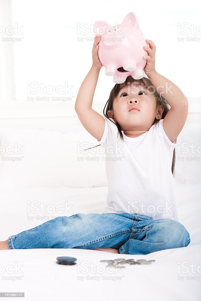 Girl empty piggy bank royalty-free stock photo