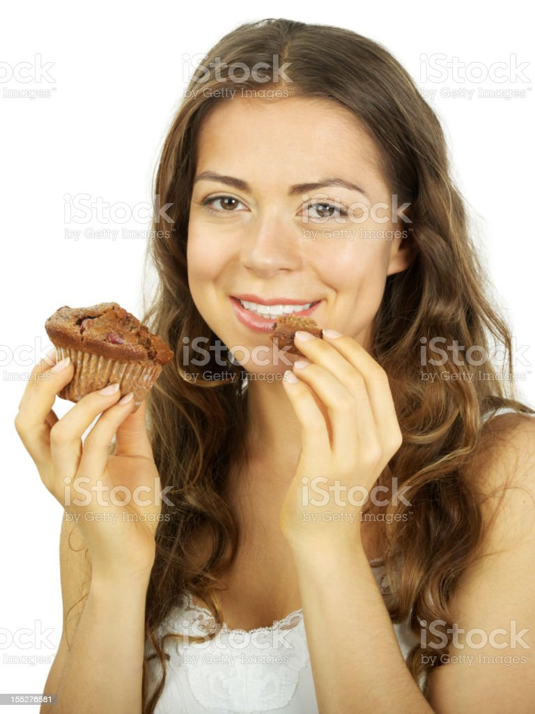 Girl enjoy eating a blueberry muffin and smiling royalty-free stock photo