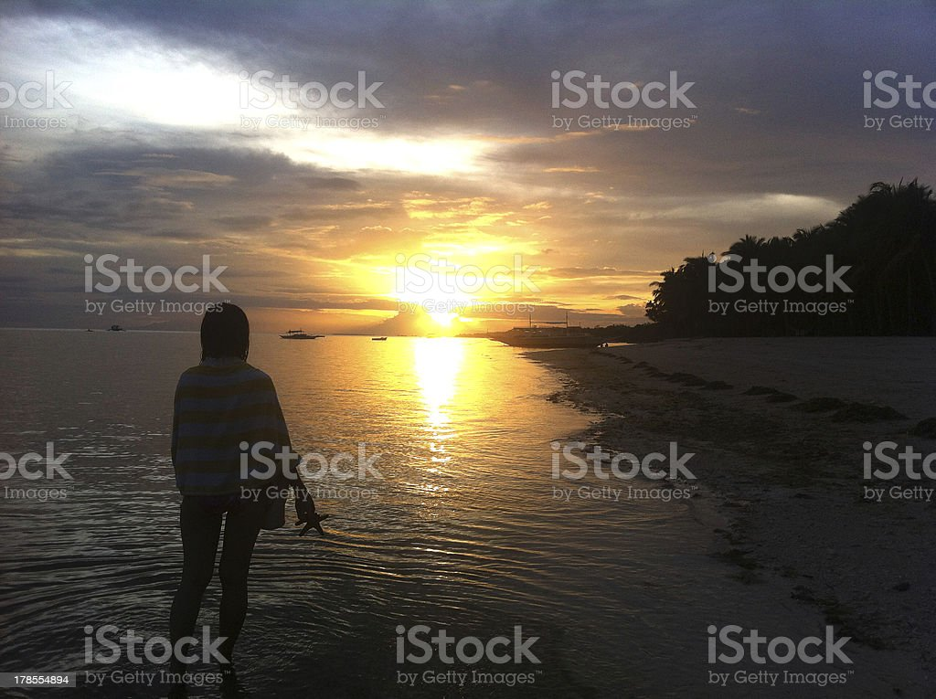Girl Enjoy Sunset in the Beach royalty-free stock photo