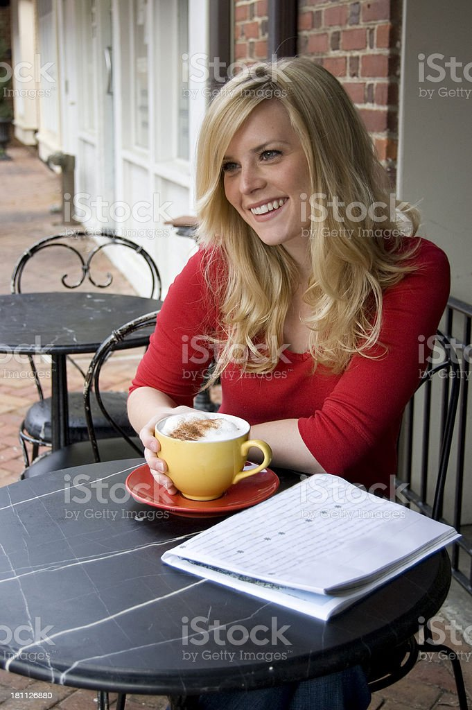 Girl enjoying coffee at a cafe royalty-free stock photo