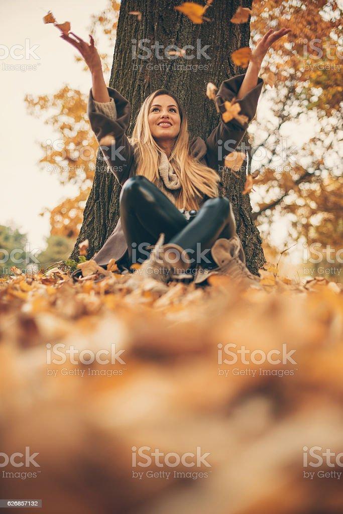 Girl enjoying day in park stock photo