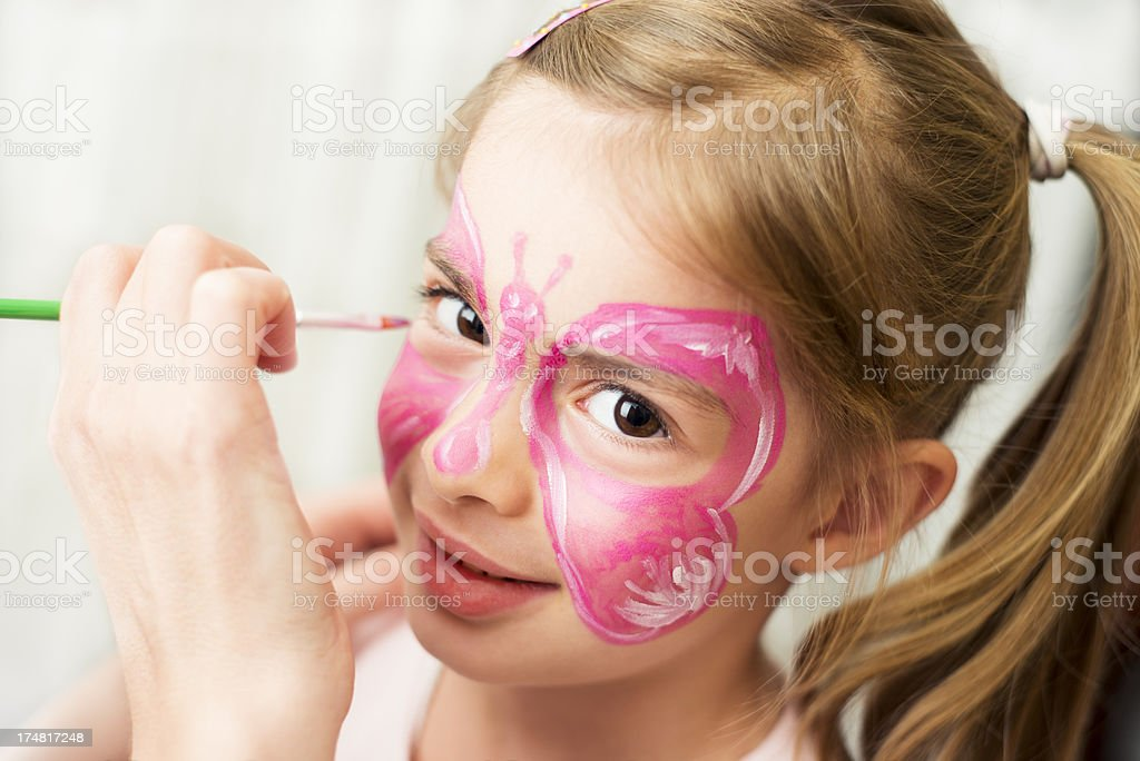 Girl enjoying face painting stock photo