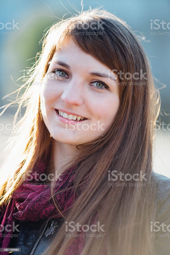 Girl enjoying her time outside in park with sunset stock photo