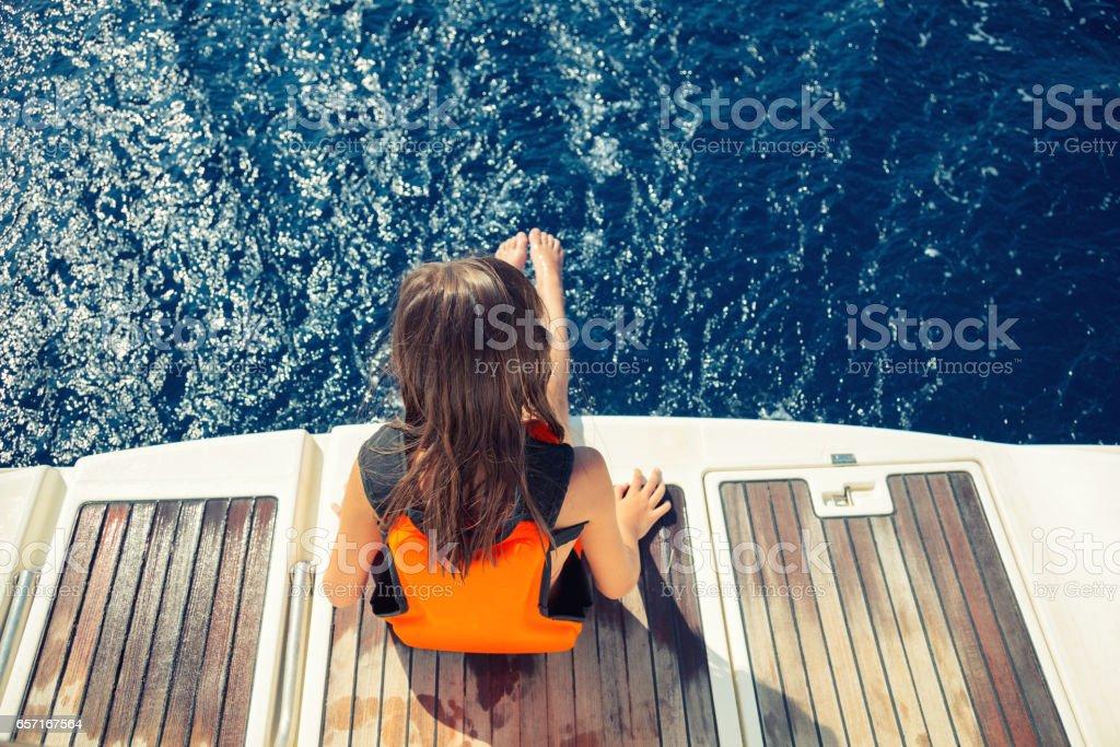 Girl enjoying her vacation on sailboat stock photo