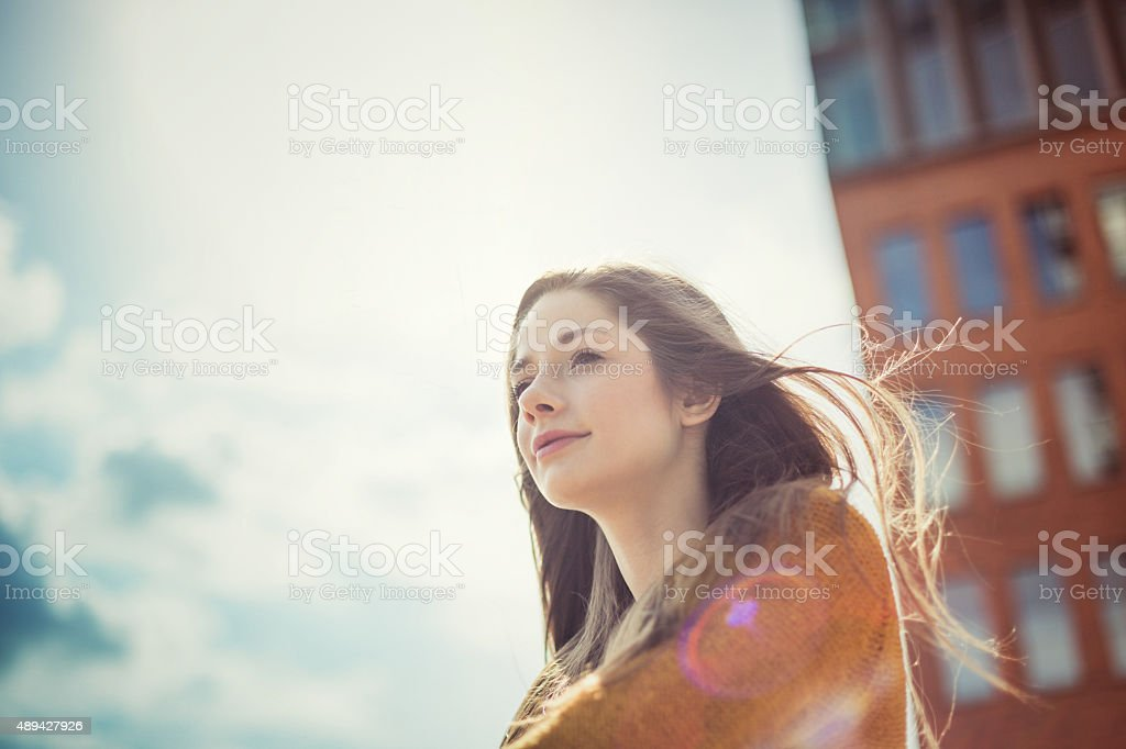 Girl enjoying sunlight with dreamy look stock photo