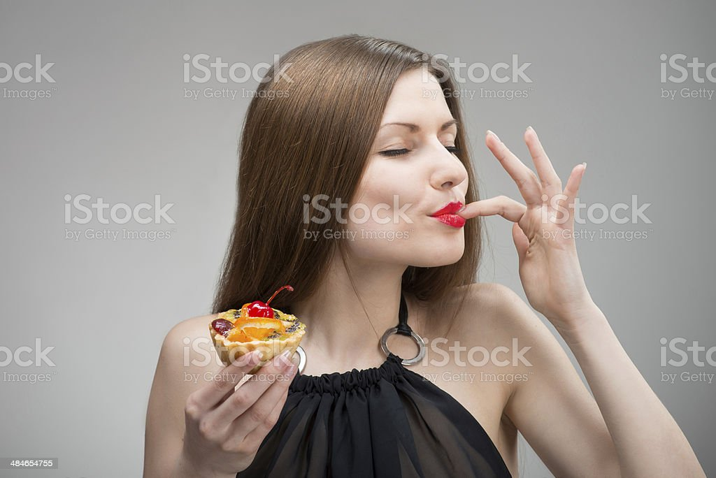 Girl enjoying the cake stock photo