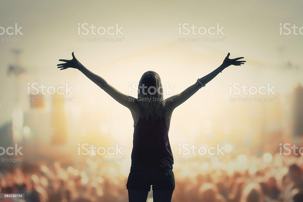 Girl enjoying the music festival / concert. stock photo