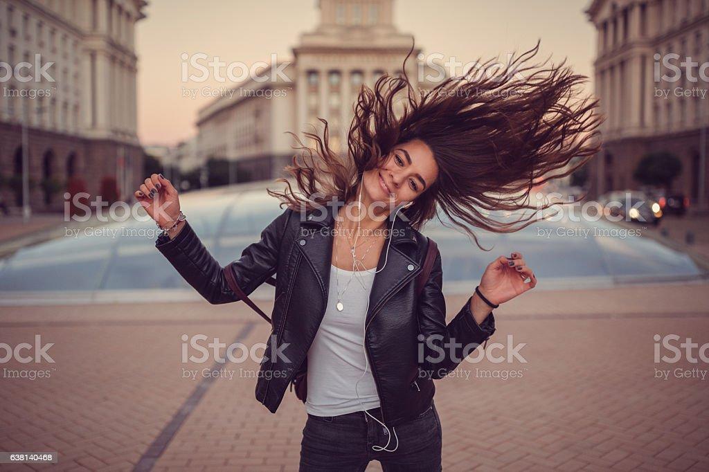 Girl enjoying the music stock photo