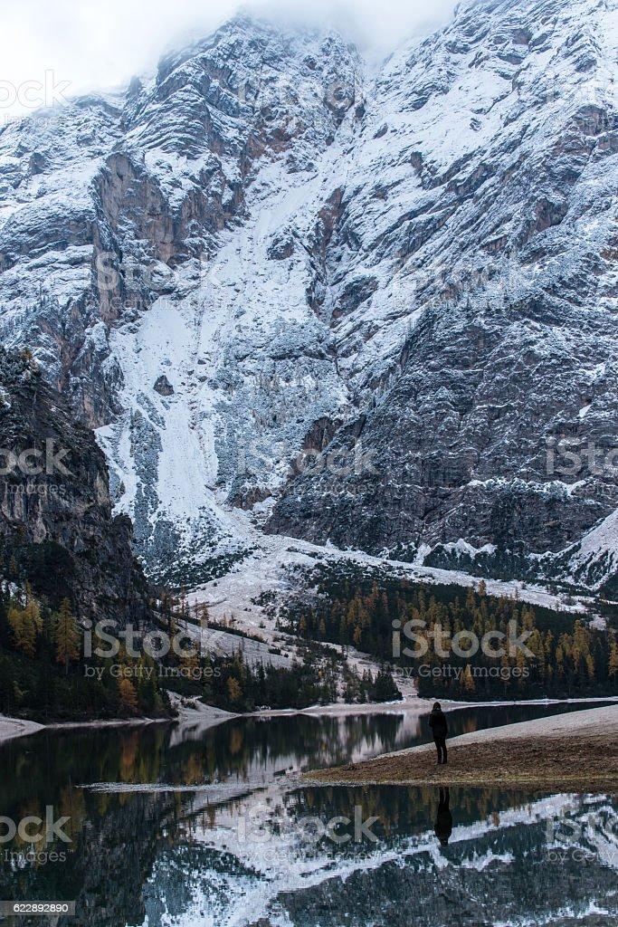Girl enjoys beautiful Lago di Braies stock photo
