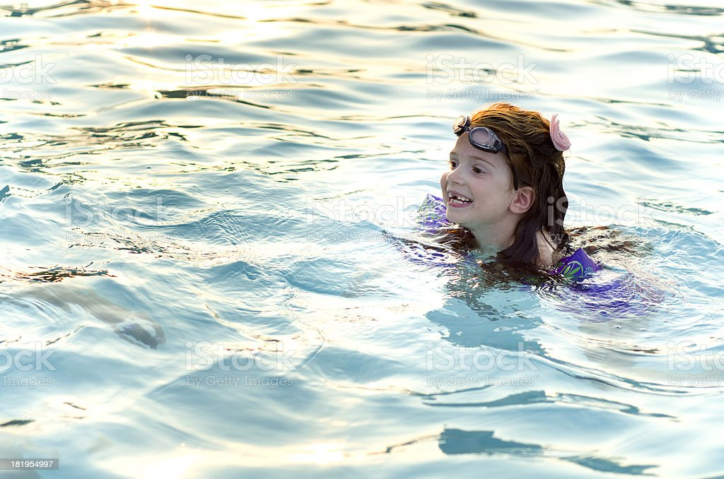 girl enjoys swimming in the water royalty-free stock photo