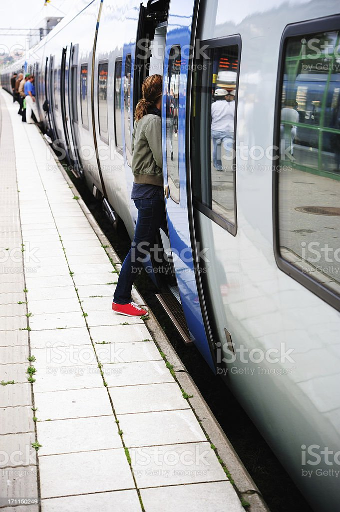 Girl entering train, mid day light royalty-free stock photo